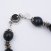 Closeup Clasp on the Midnight Comet Necklace by Vibrant and Sage with Art Glass, Stone, and Sterling Silver