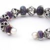 Cosmic Cuff Bracelet End View by Vibrant and Sage with Art Glass, Sterling Silver, and Indonesian open-work beads in deep purple and blue