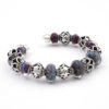 Cosmic Cuff Bracelet Side View by Vibrant and Sage with Art Glass, Sterling Silver, and Indonesian open-work beads in deep purple and blue