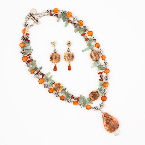 a double strand necklace with amber, sage green kyanite spears and open silver beads and glass art pendant