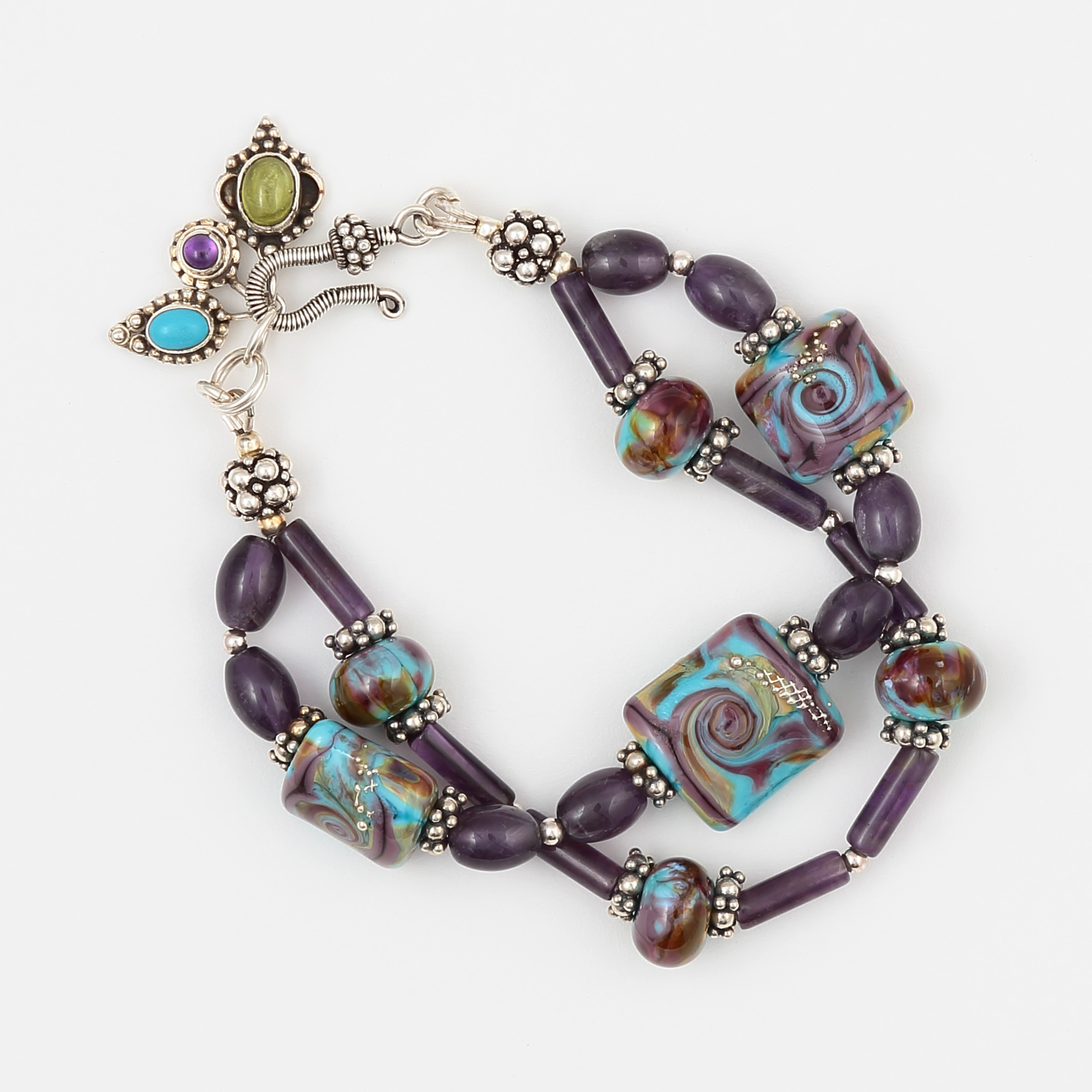 HYPNOTIQUE BRACELET- Amethyst, Peridot, Turquoise with blue, gold, and purple art glass and sterling silver