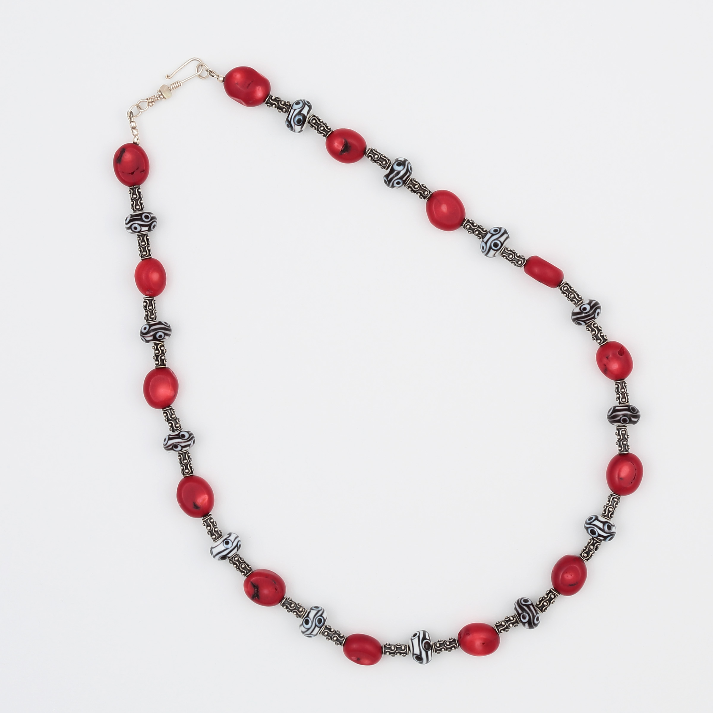 Handmade black and white art glass necklace with red coral beads and sterling silver
