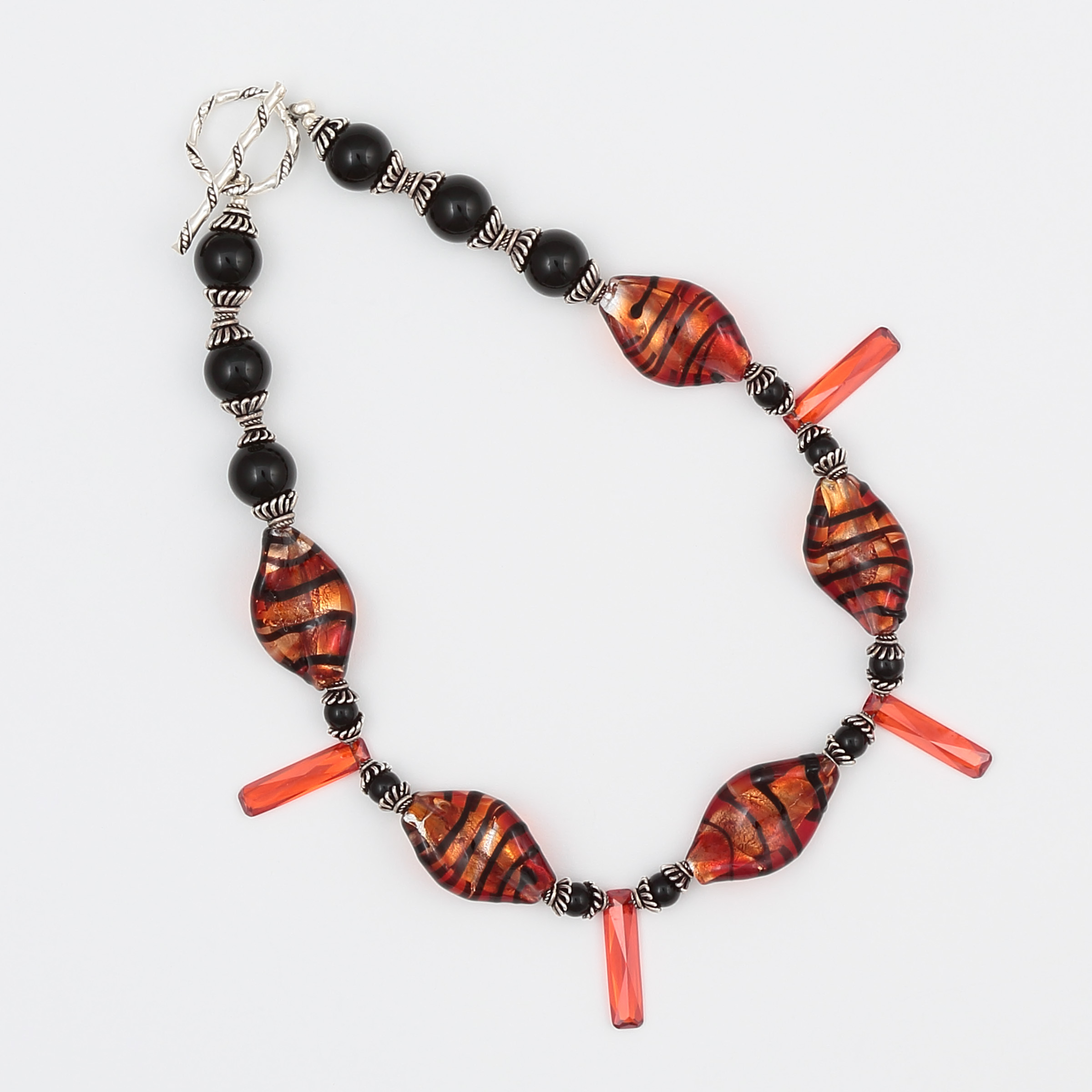 UNIQUITY NECKLACE- Orange and black art glass with onyx and sterling silver